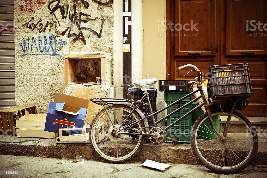 Bicycle leaning against a wall stock photo