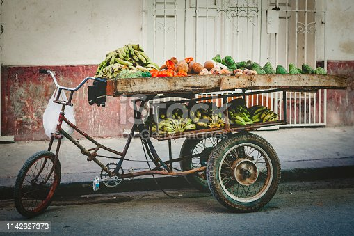 mobile fruit shop, bicycle loaded full of fruits and vegetables in havana, cuba.