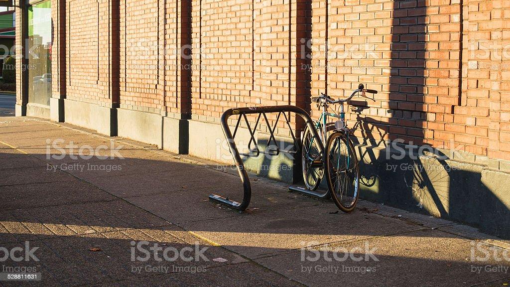 bicycle locked to bike rack stock photo