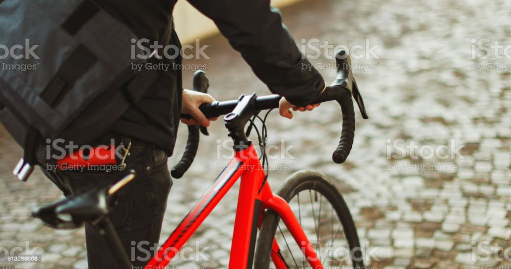 Bicycle messenger: commuter with road bicycle in the city stock photo