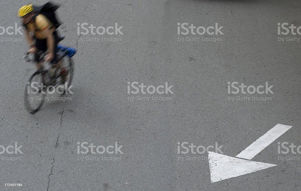 Bicycle messenger follows arrow in San Francisco royalty-free stock photo