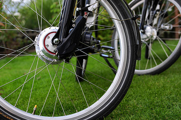 bicycle motor Electric bicycle motor in the front.Pedelec electric bicycle. front wheel motor  electric bike stock pictures, royalty-free photos & images