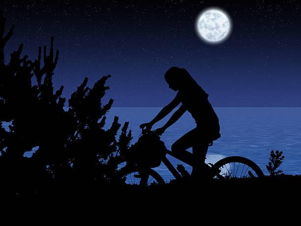 Bicycle night rider stock photo