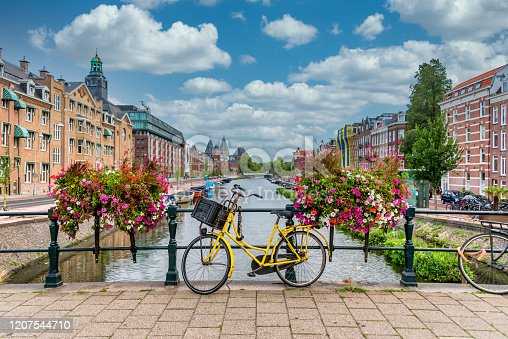 Bicycle on a Bridge over a Canal in Amsterdam Netherlands with Blue Sky