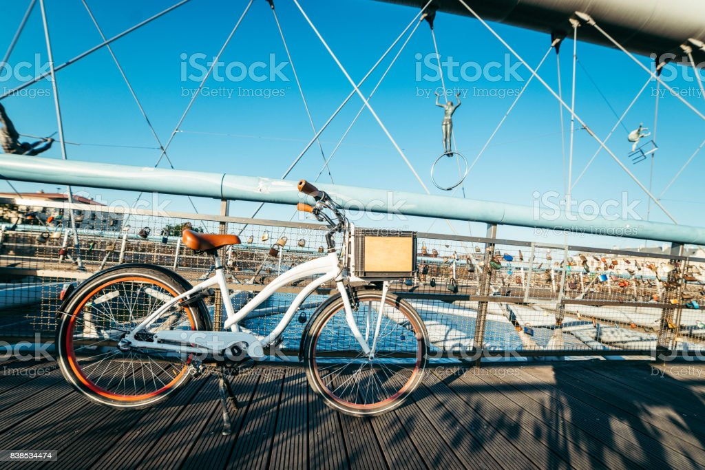 bicycle on the bridge cross the river stock photo