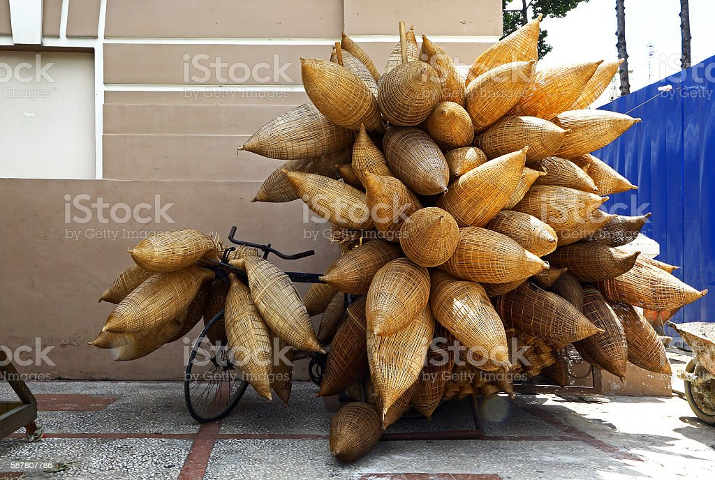 Bicycle overloaded with wicker fish traps in Vietnam stock photo