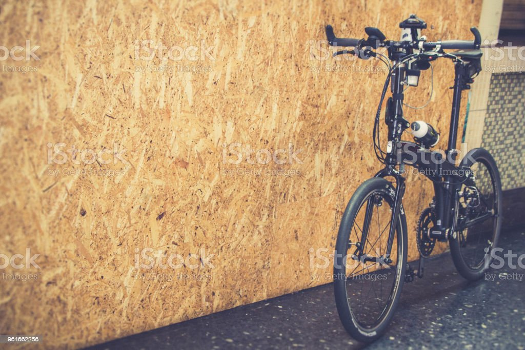 bicycle park leaning on the wall royalty-free stock photo