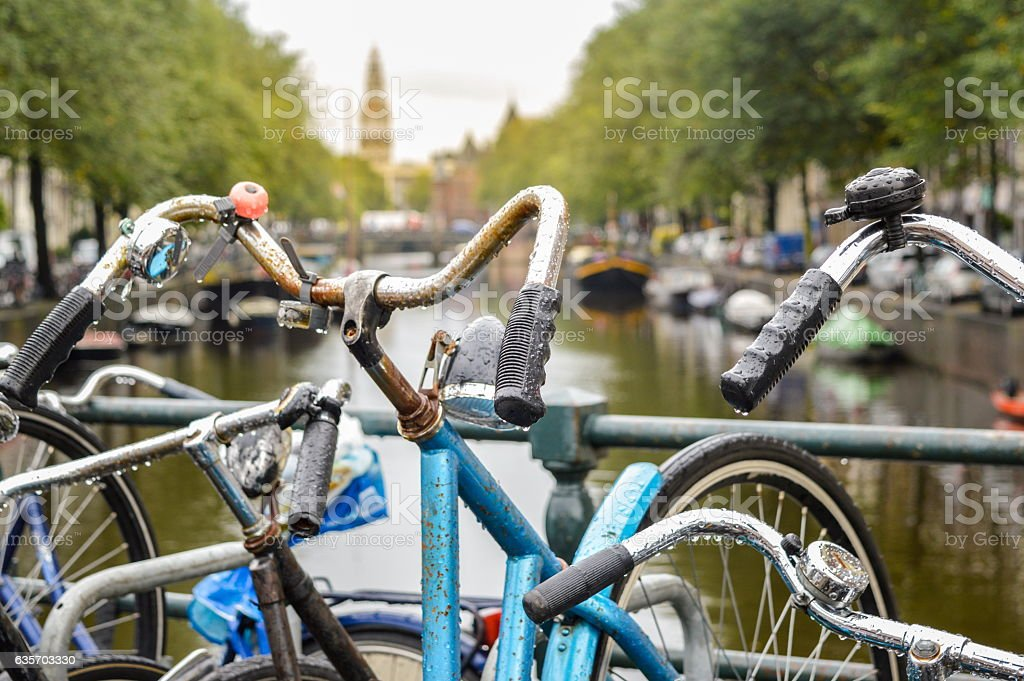 Bicycle parked on a bridge in Amsterdam city center royalty-free stock photo