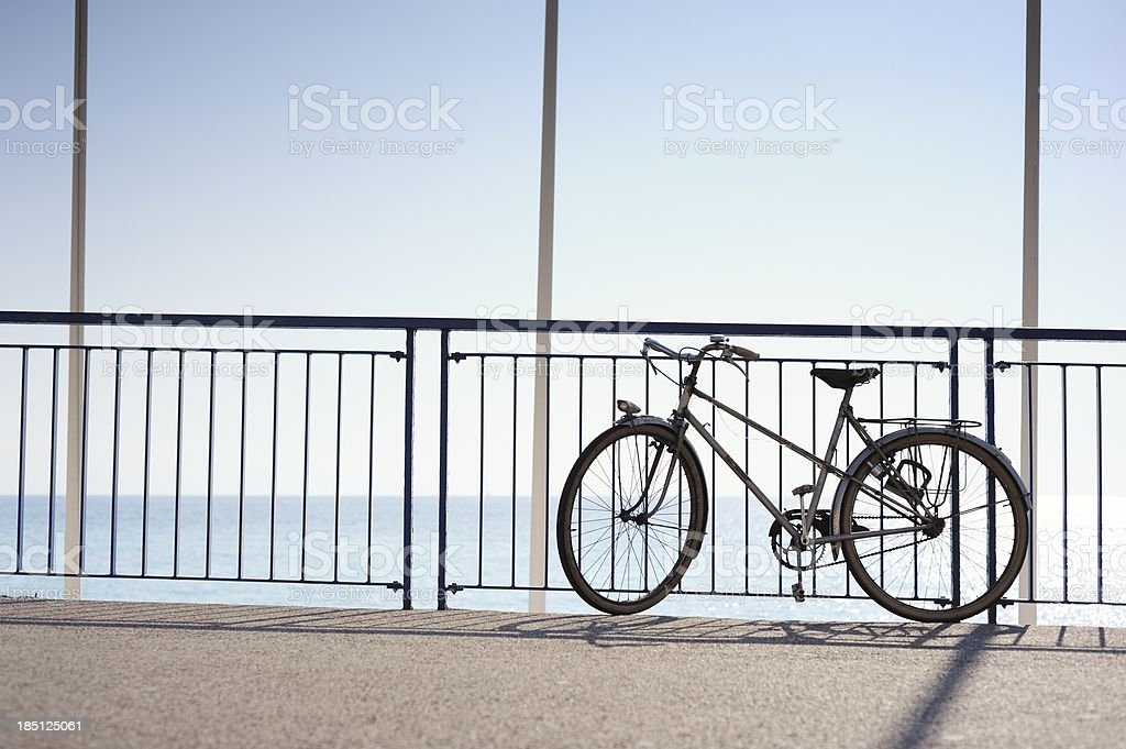 Bicycle Parked on a Sunny Promenade by the Sea royalty-free stock photo