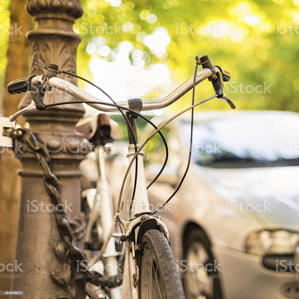 Bicycle parked on the city royalty-free stock photo