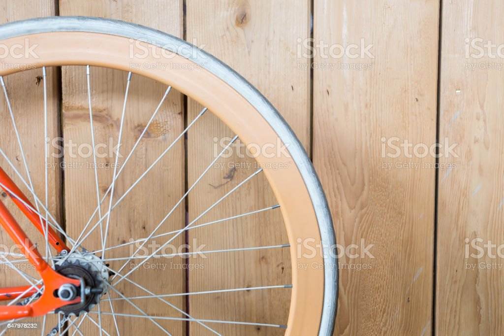 bicycle parked with wood wall, close up image part of bicycle stock photo