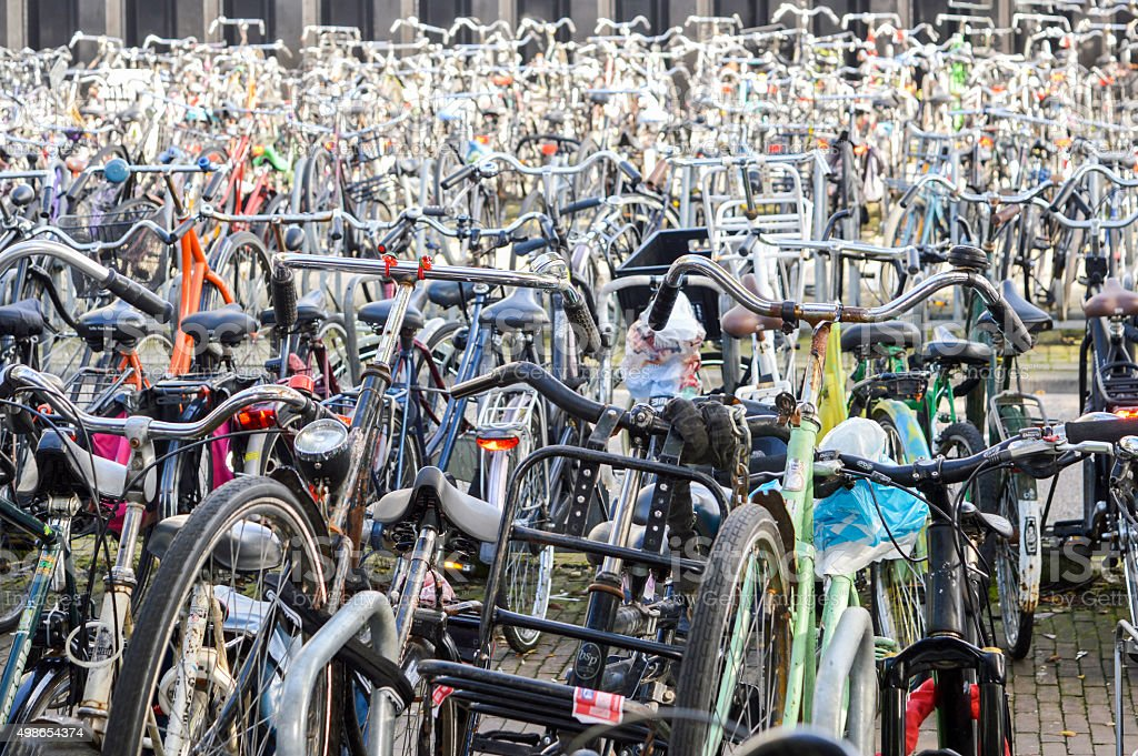Bicycle parking organized chaos in Amsterdam, Netherlands stock photo