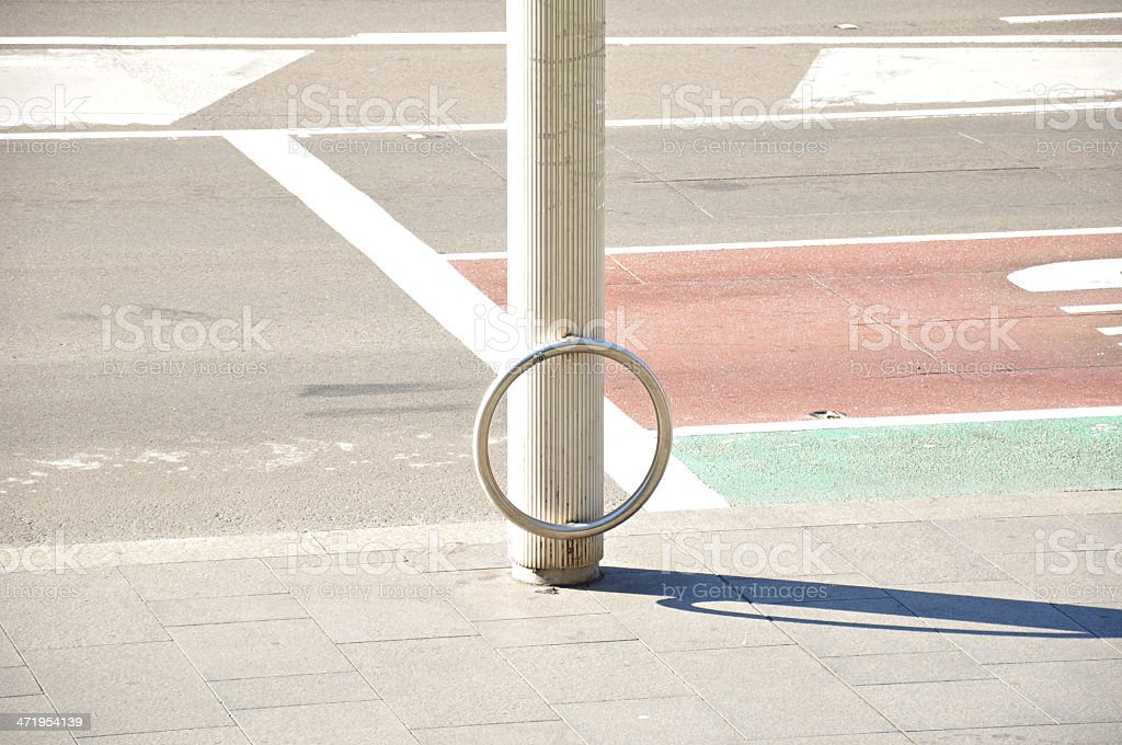 Bicycle parking ring beside the street stock photo