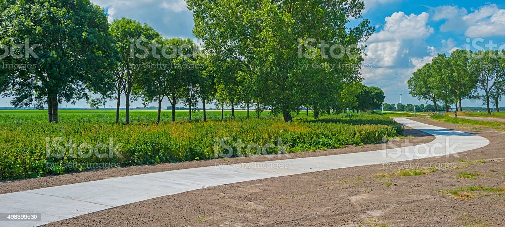Bicycle path meandering through a rural landscape stock photo