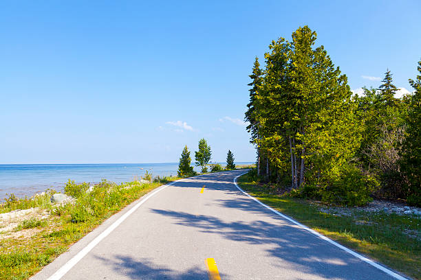 bicycle path on mackinac island - mackinac island stock photos and pictures