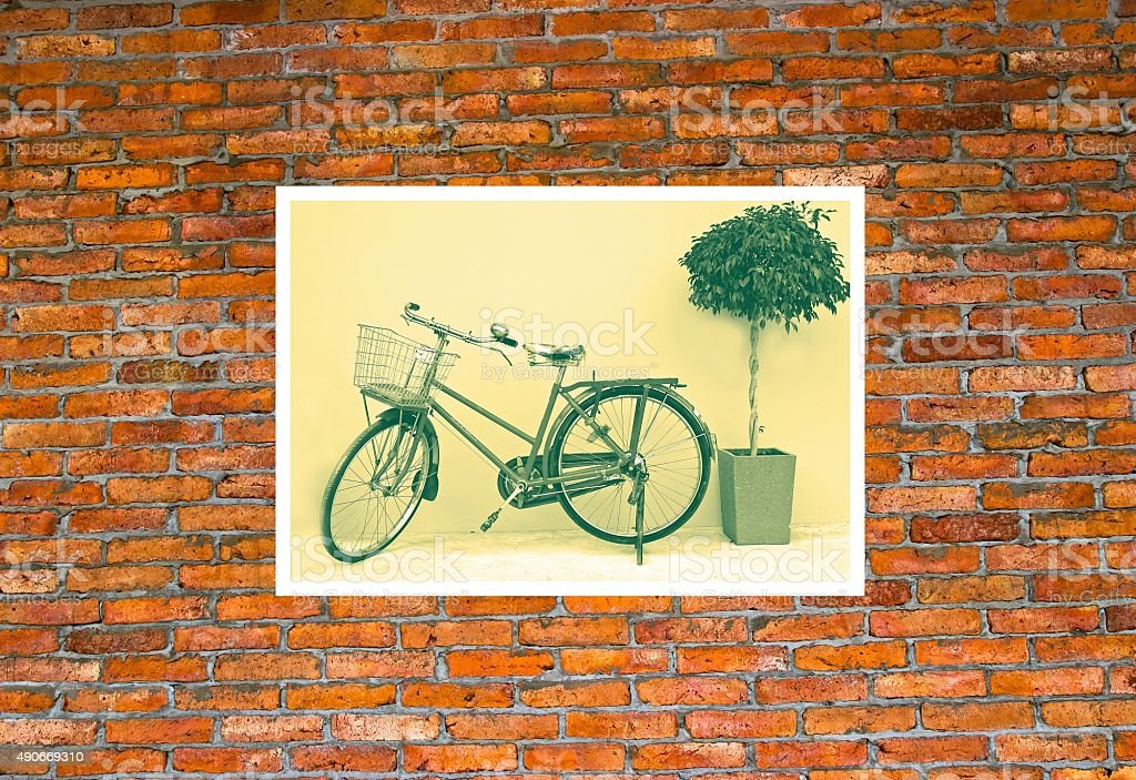 Bicycle photo on brick wall. stock photo