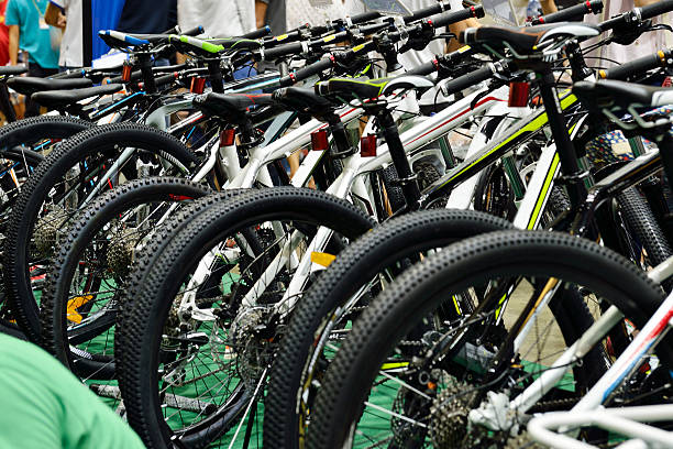 Bicycle Bikes parked in a row. bicycle shop stock pictures, royalty-free photos & images