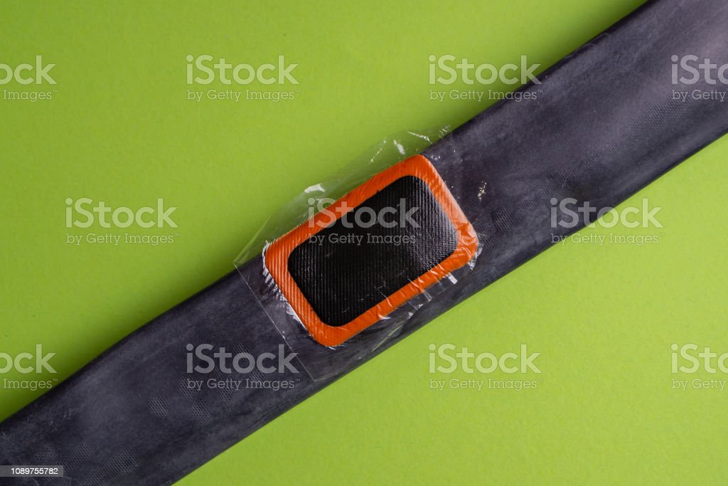 Bicycle Repair Kit Wheels Camera On Wooden Background Patch