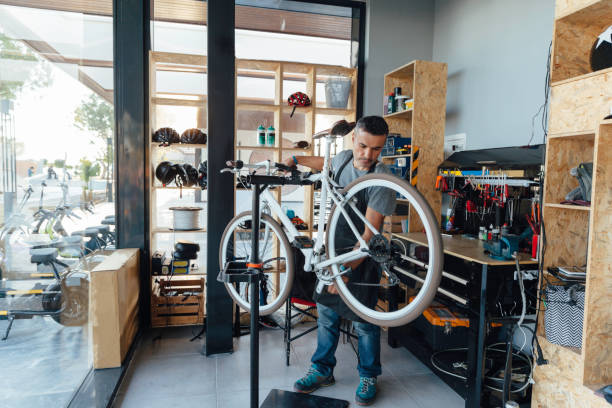 Bicycle repair Bicycle repair bicycle shop stock pictures, royalty-free photos & images