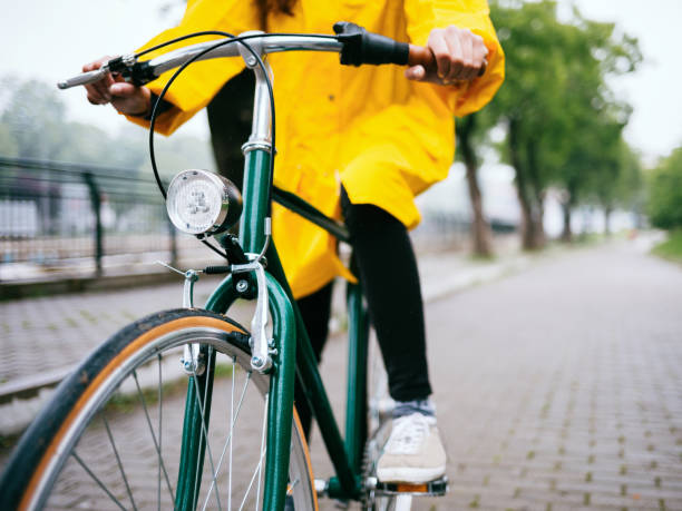 Bicycle ride in the rain stock photo