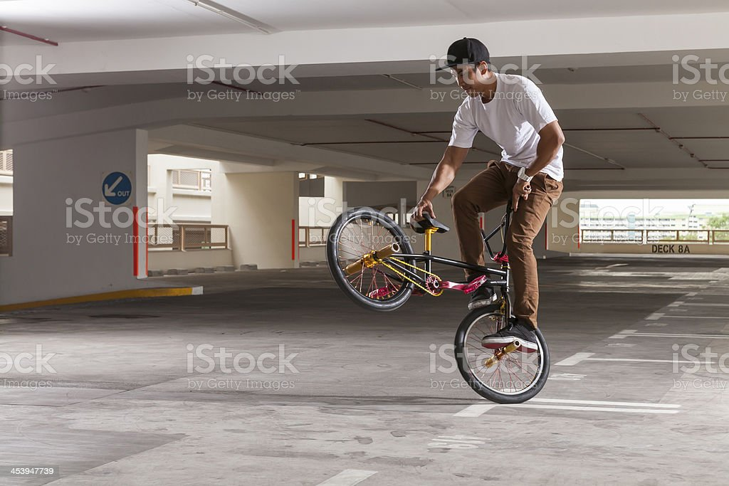 BMX Bicycle rider doing his stunt stock photo
