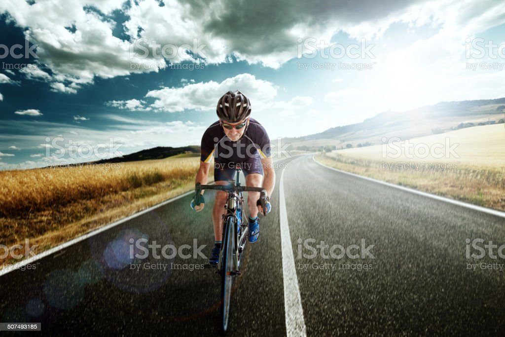 Bicycle Rider pedaling on a Country Highway royalty-free stock photo