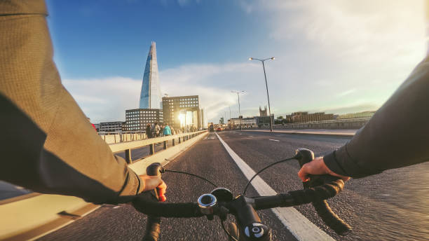 POV bicycle riding: commuter with road racing bike in London stock photo