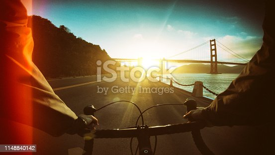 POV bicycle riding: commuter with road racing bike in San Francisco, near Golden Gate Bridge