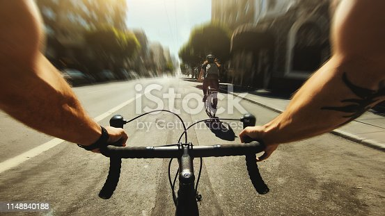 POV bicycle riding: commuter with road racing bike in San Francisco, Financial District