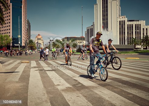 Mexico City, Mexico - August 22, 2018: People enjoy the bicycle day of Mexico City under a Summer blue sky.