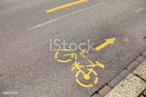 close up shot of bicycle route sign on street in Zurich, Switzerland.