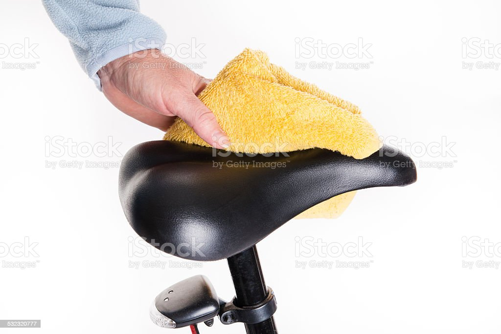 Bicycle saddle cleaning of dust with a wet cloth stock photo