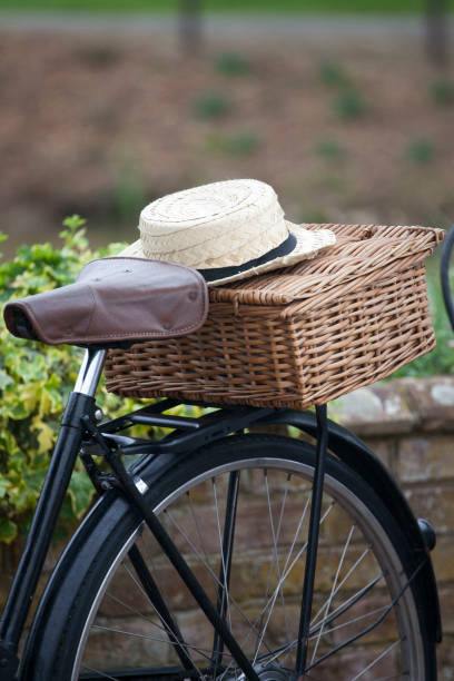 Bicycle seat and straw hat stock photo