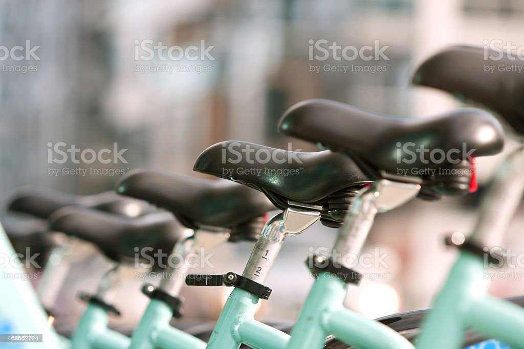 Bicycle Seats Are Uniformly Lined Up In A Row stock photo