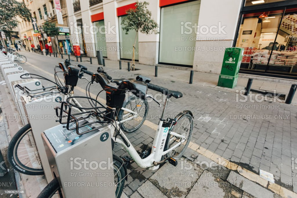 bicycle sharing stations around the city stock photo