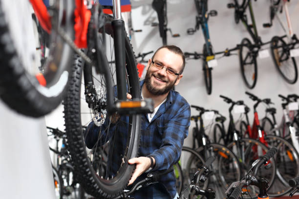 Bicycle shop. Bicycle seller in a bicycle lounge. bicycle shop stock pictures, royalty-free photos & images