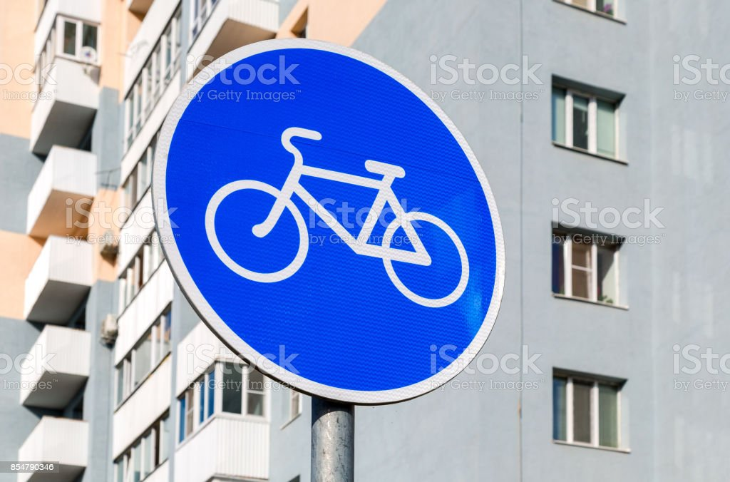 Bicycle sign for bikes lane against the apartment house stock photo