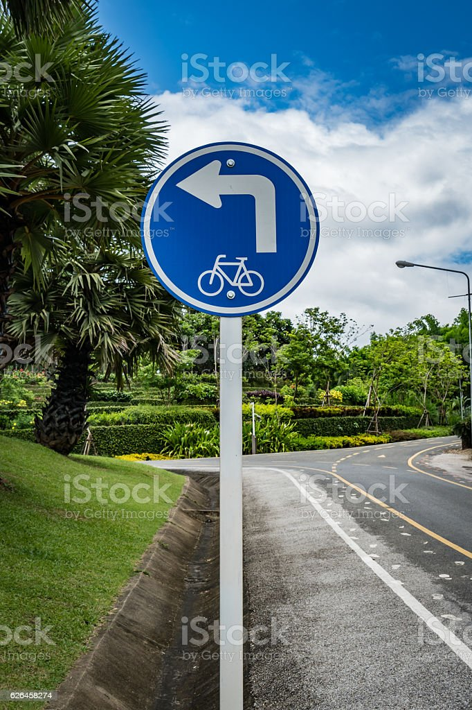 Bicycle sign in the park stock photo