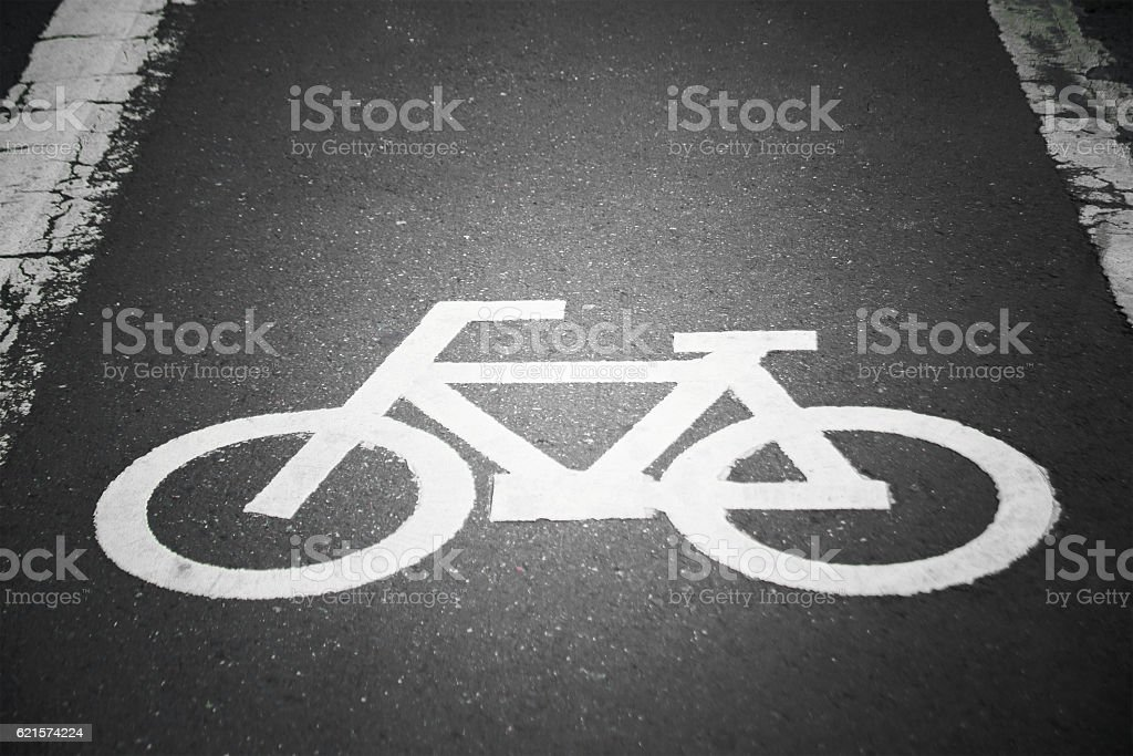 Bicycle sign on a street background process in vintage style - foto de acervo