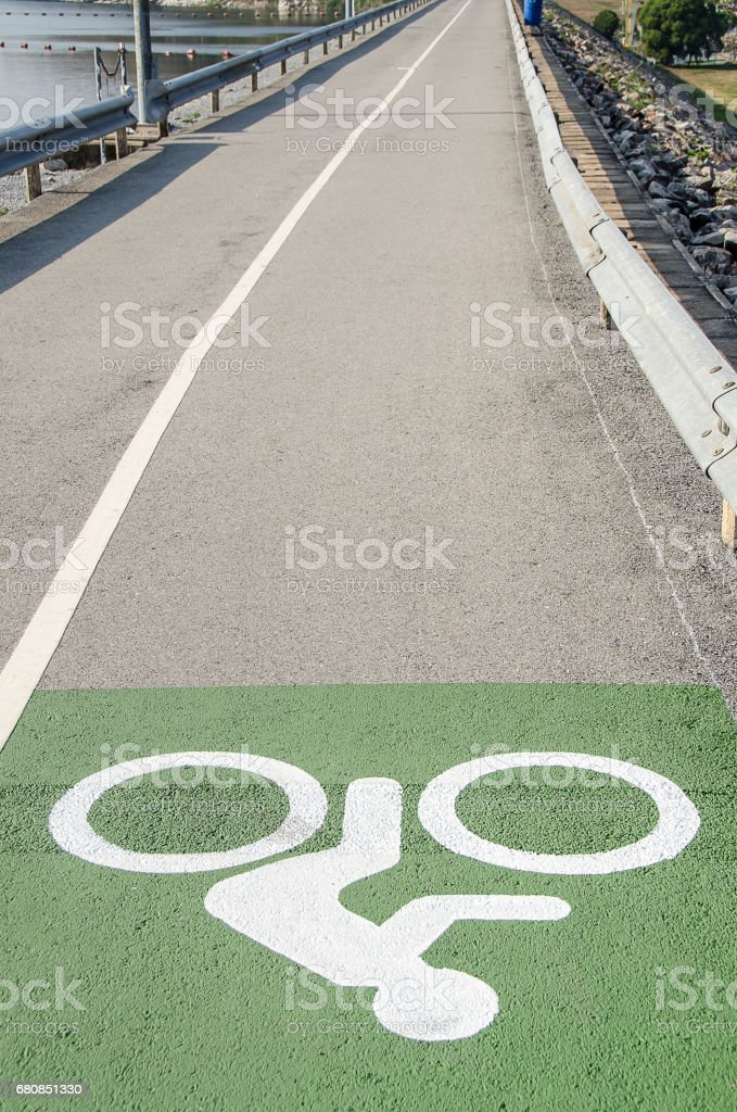 Bicycle sign or icon on the road in the dam. royalty-free stock photo