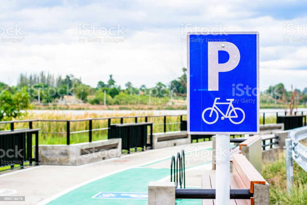 Bicycle sign park on the road stock photo