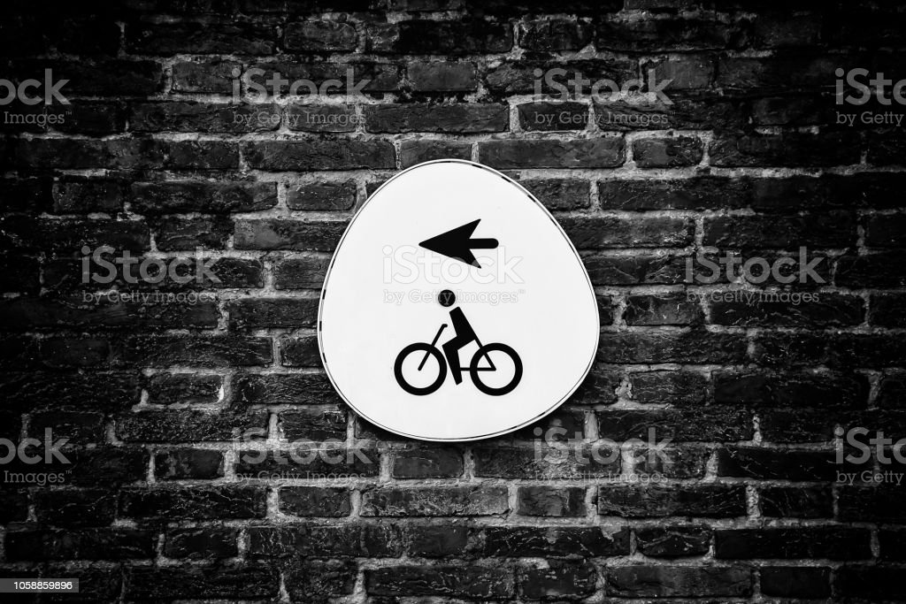 Bicycle sign with arrow stock photo
