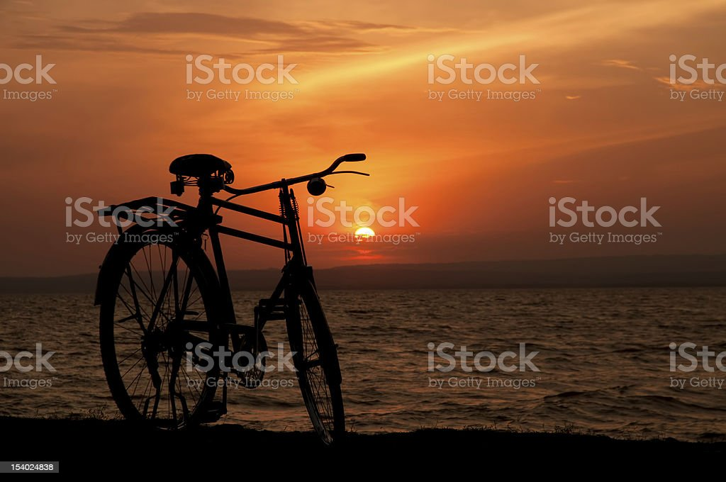 Bicycle silhouette in sunset stock photo