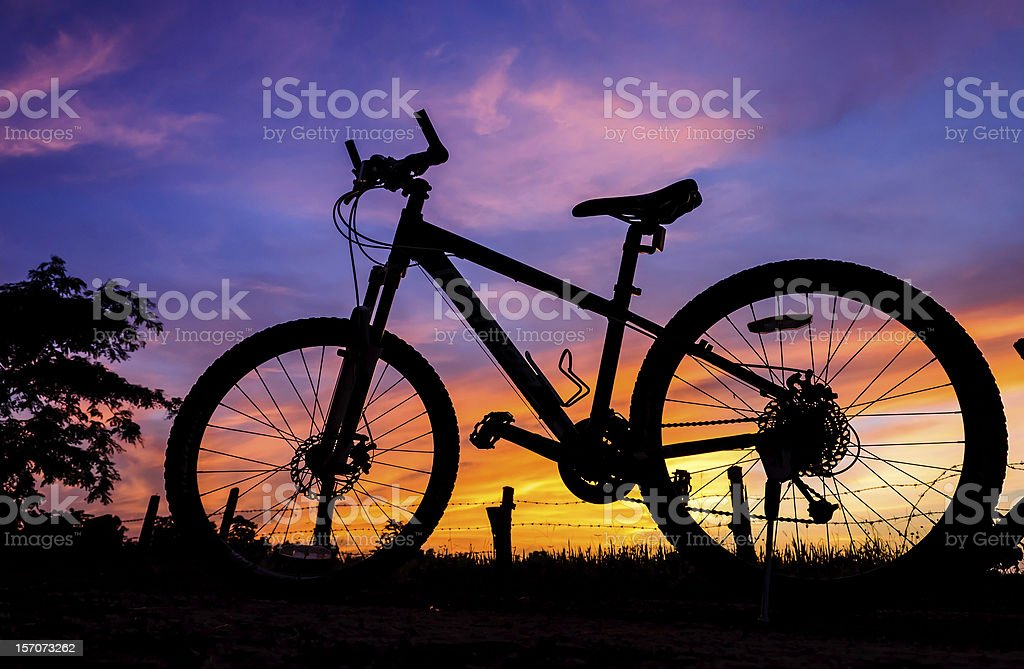 Bicycle silhouette on a sunset royalty-free stock photo
