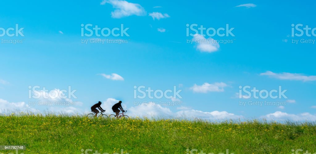 bicycle silhouettes on the dyke stock photo