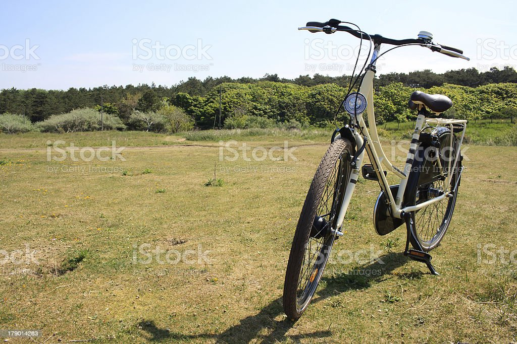 Bicycle standing in field royalty-free stock photo