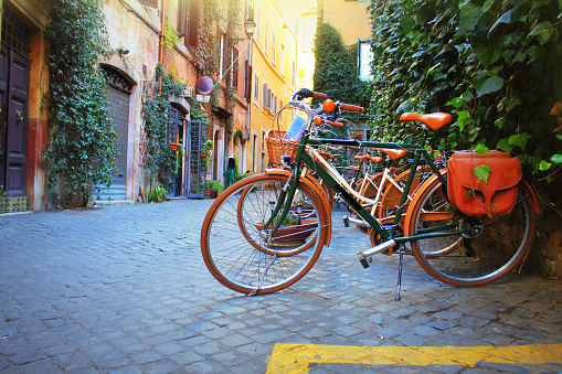 Bicycle Standing In Front Of Store On Old Street Of Rome Stock Photo - Download Image Now