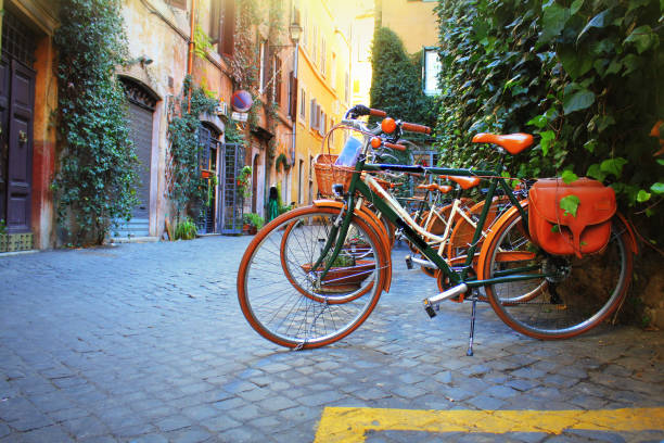 Bicycle standing in front of store on old street of Rome . stock photo