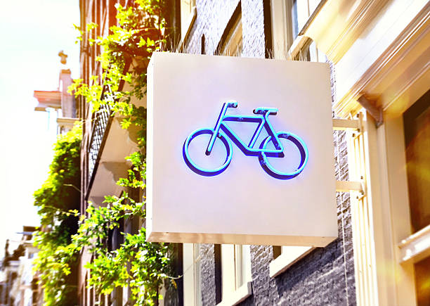 Bicycle store Bicycle sign of a bicycle shop. Building exterior of a bicycle shop in the sunlight. bicycle shop stock pictures, royalty-free photos & images