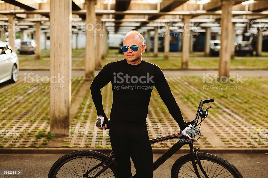 bicycle style man in black sportswear royalty-free stock photo